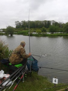 An angler getting his elastic pulled by one of the venues hard fighting carp.